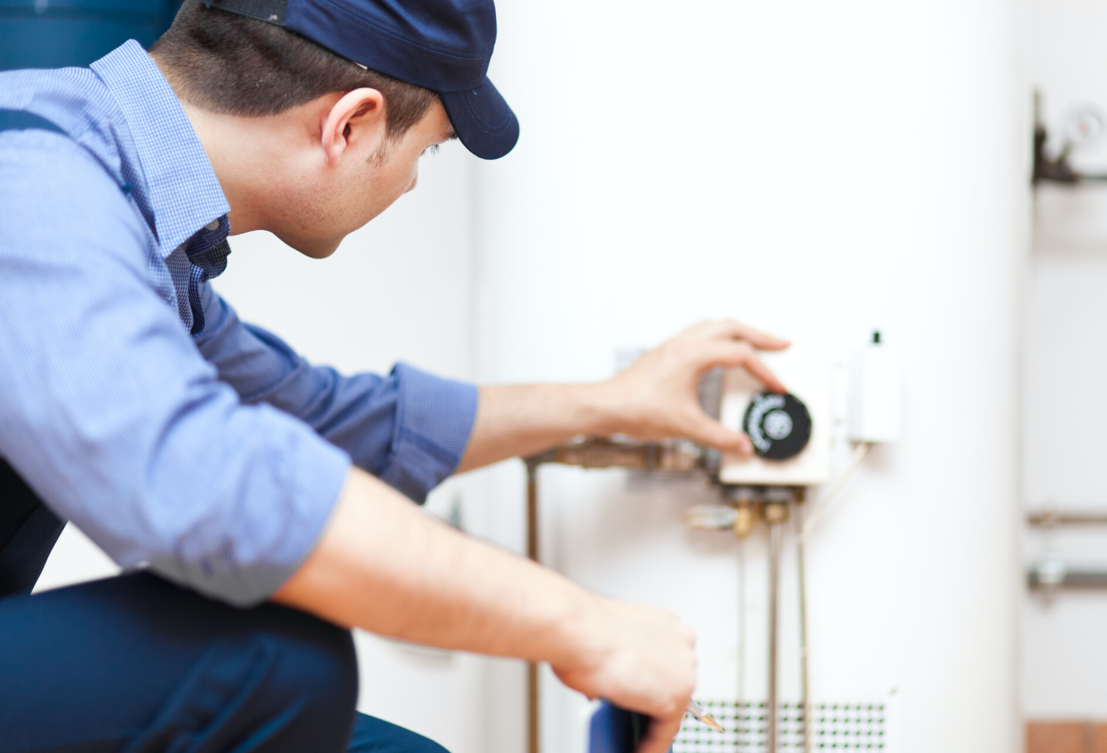 tech checking water heater